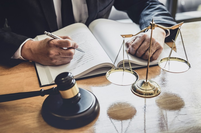 Professional Male lawyer or judge working with contract papers,